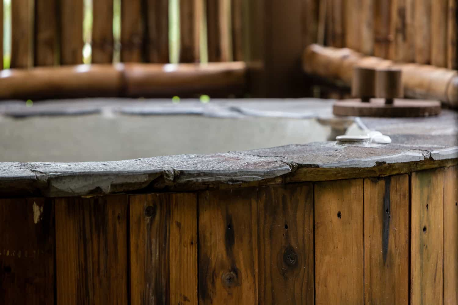 Outdoor covered hot tub for just married couple at El Silencio Lodge.