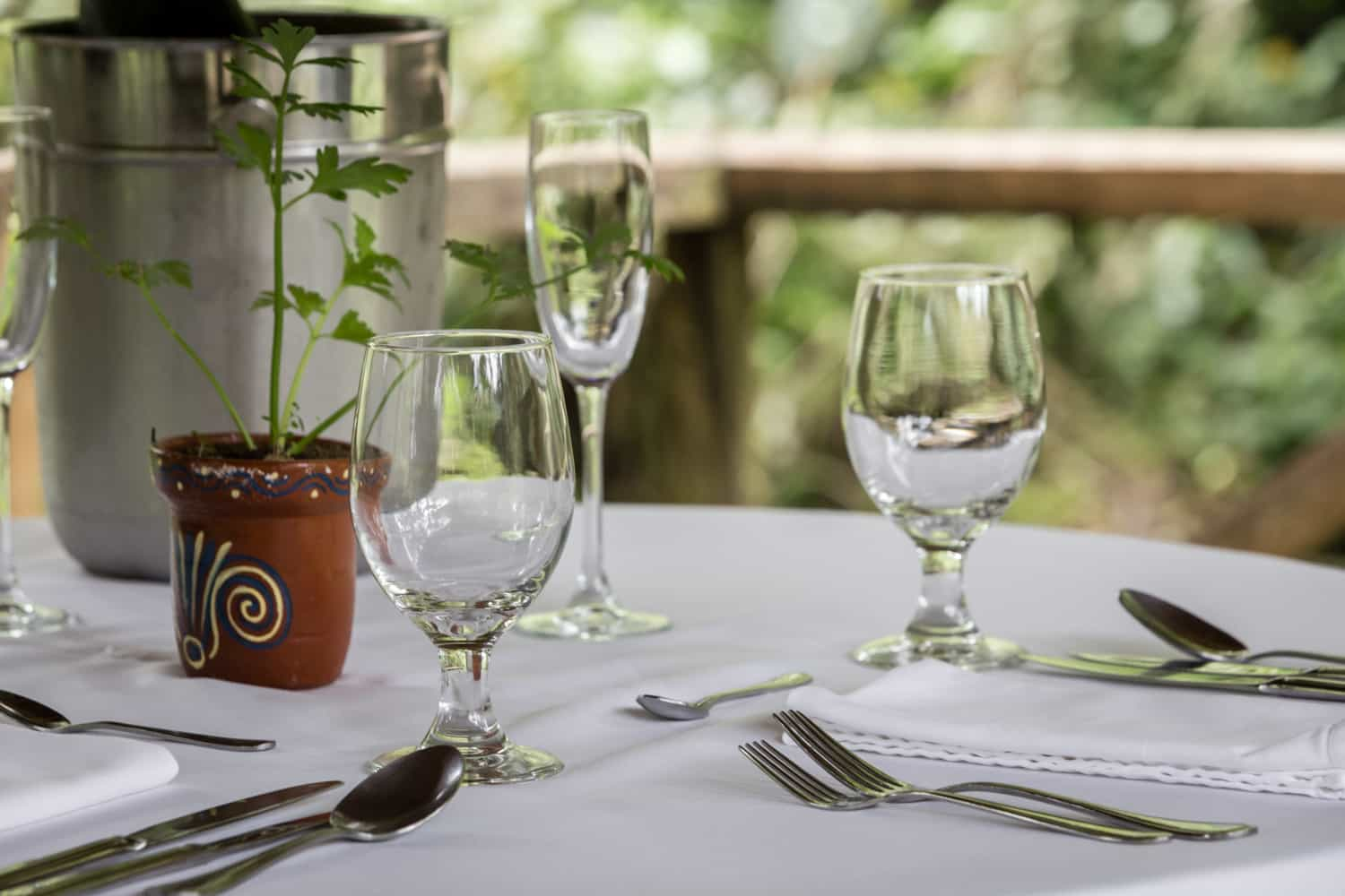 Table set for just marred couple in cloud forest gazebo.