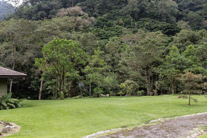 Mountain bordering lawn at El Silencio Lodge is ideal for weddings.