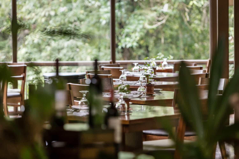 Wood tables in center of area for reception parties at El Silencio Lodge.