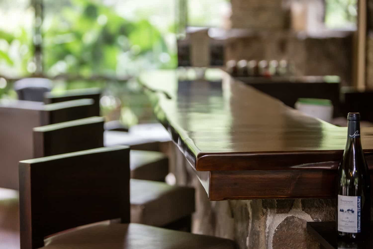 Wood bar top and chairs in wedding reception salon.