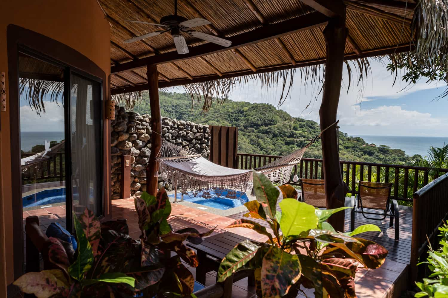 Honeymoon suite terrace with hot tub and view of ocean.