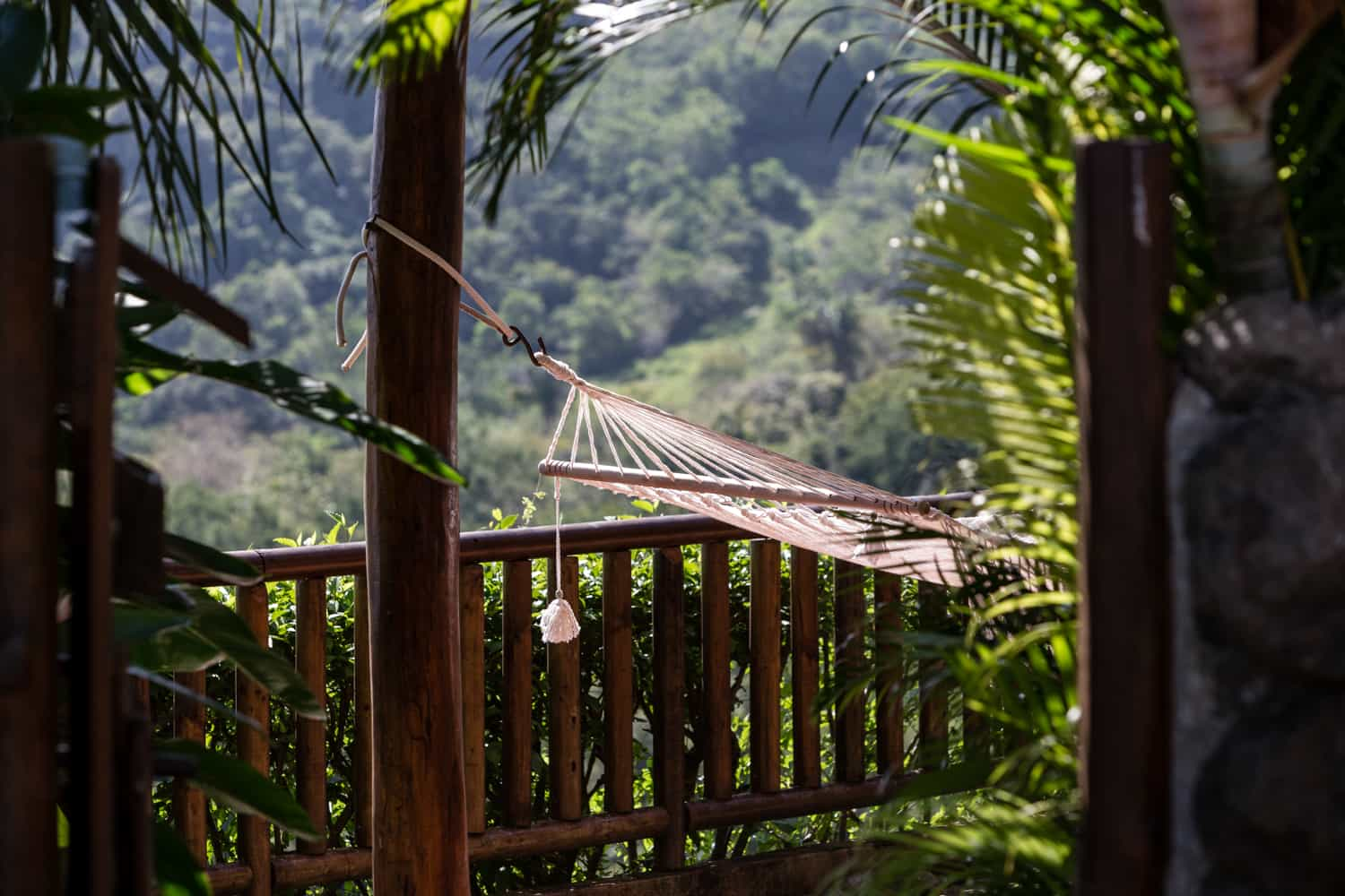 Great rainforest view from hammock in deluxe accommodations at Hotel Punta Islita.