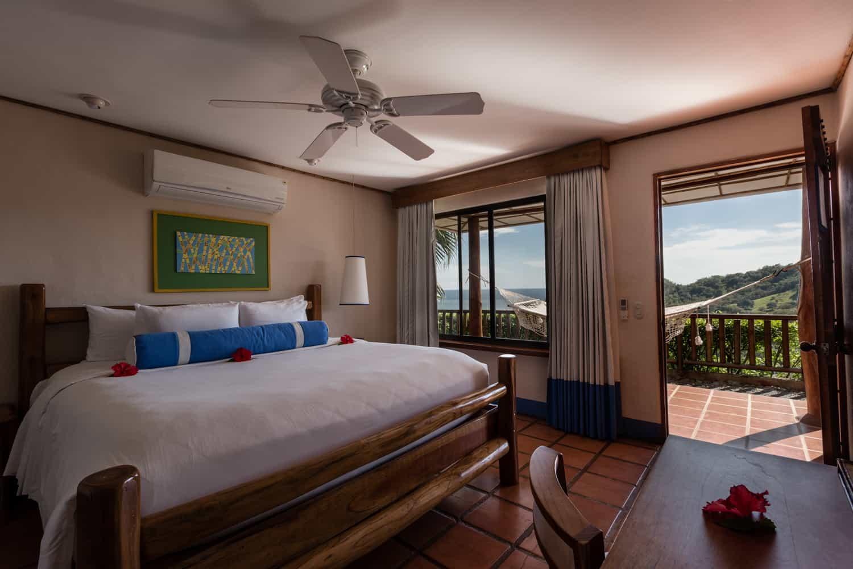 Photo of bedroom area in deluxe room at Hotel Punta Islita.