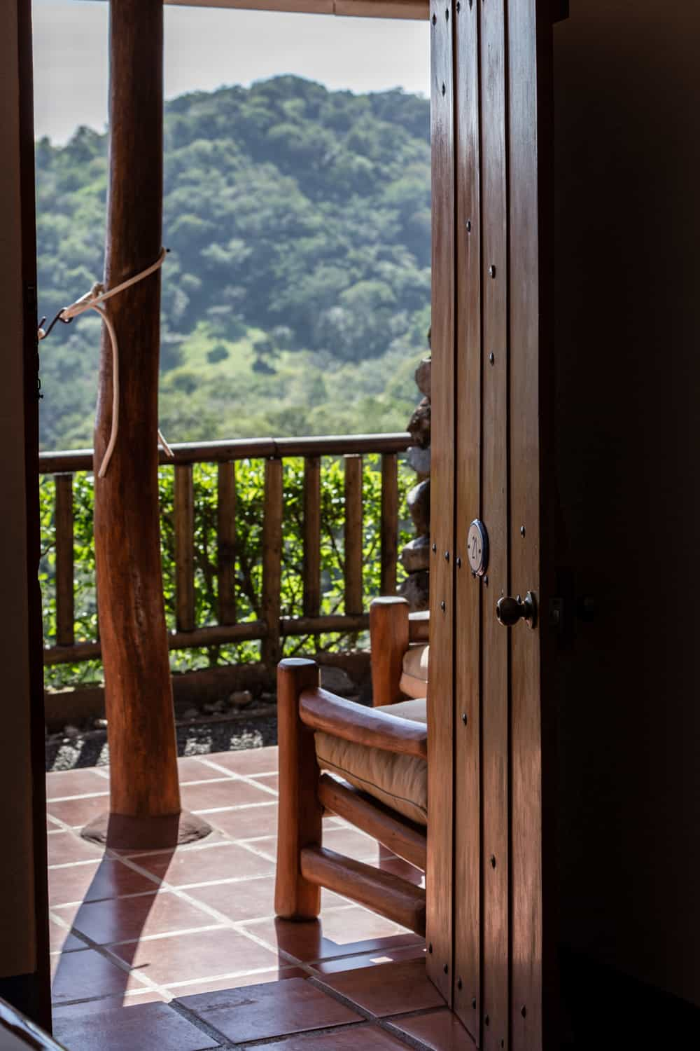 View of rainforest-covered mountain from deluxe room's entrance.