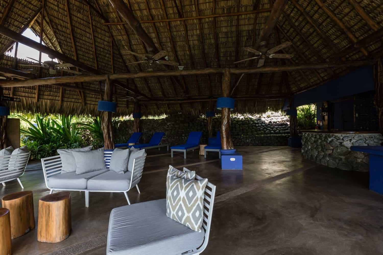 Interior of covered restaurant for beach wedding reception.