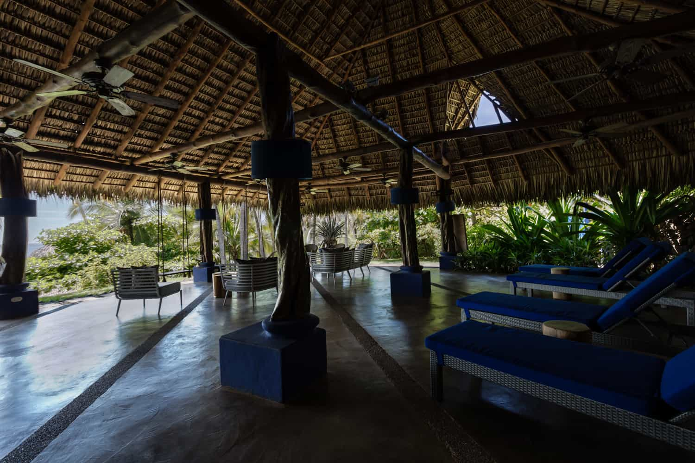Beach wedding reception area in rainforest with beach views.