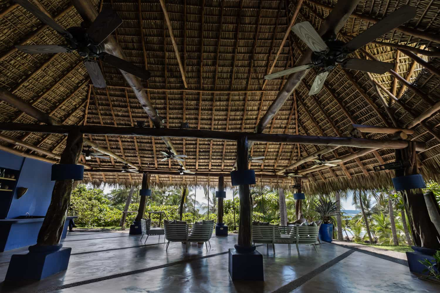 Rustic, thatched room covering beach wedding venue at Hotel Punta Islita.