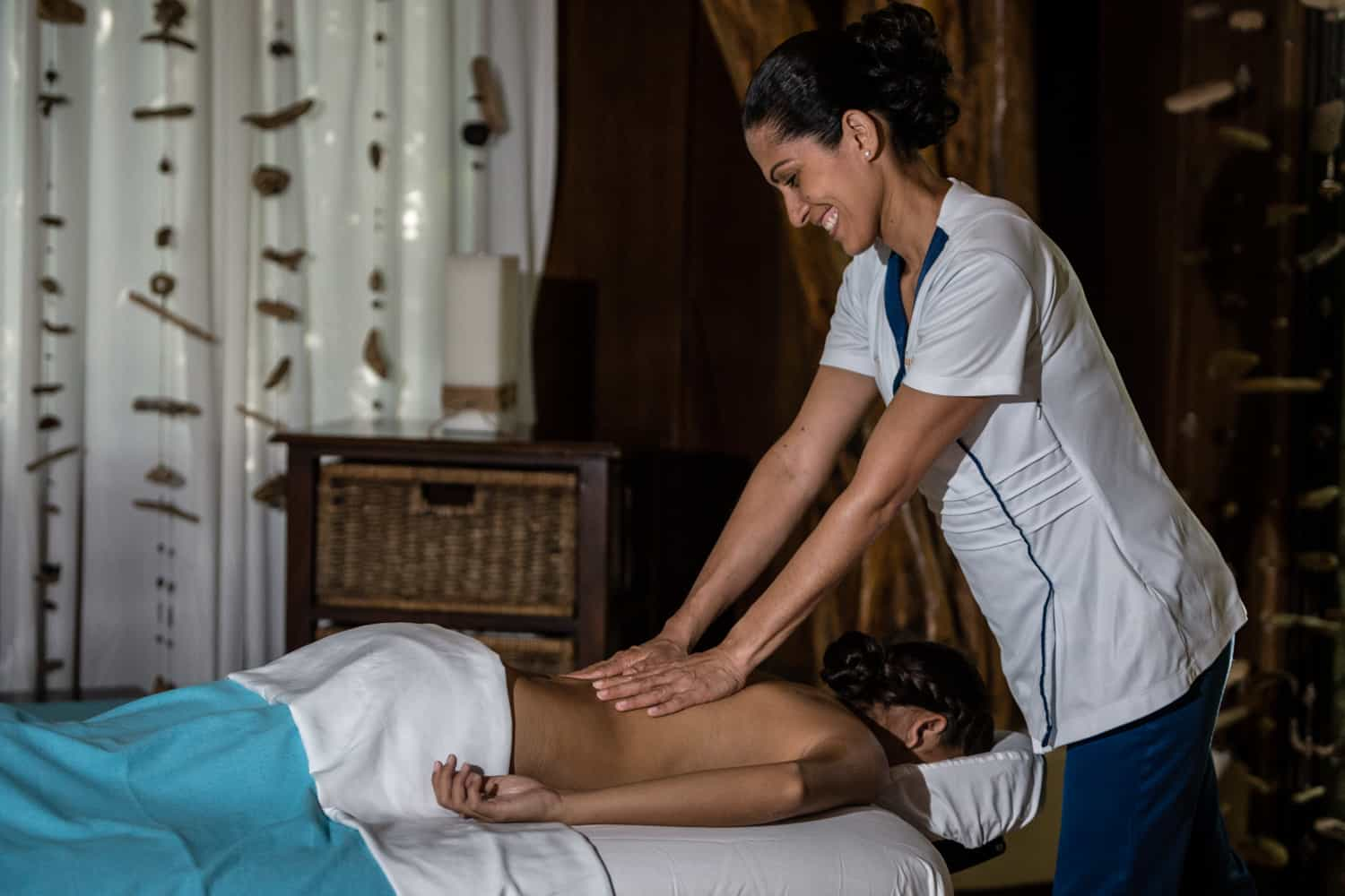 Massage therapist massing bride to be before wedding ceremony.