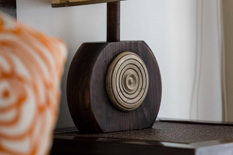 Wood clock near honeymoon suite bed in Costa Rica.