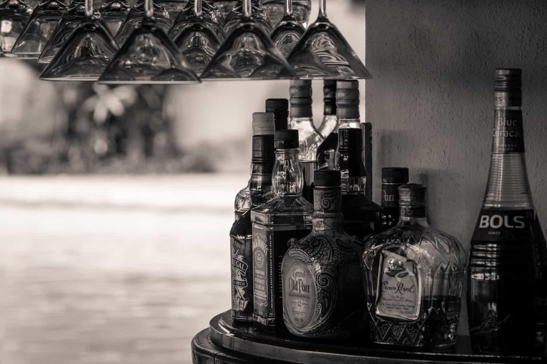 Hanging glasses and spirits at the sunken bar located next to Nasu Restaurant