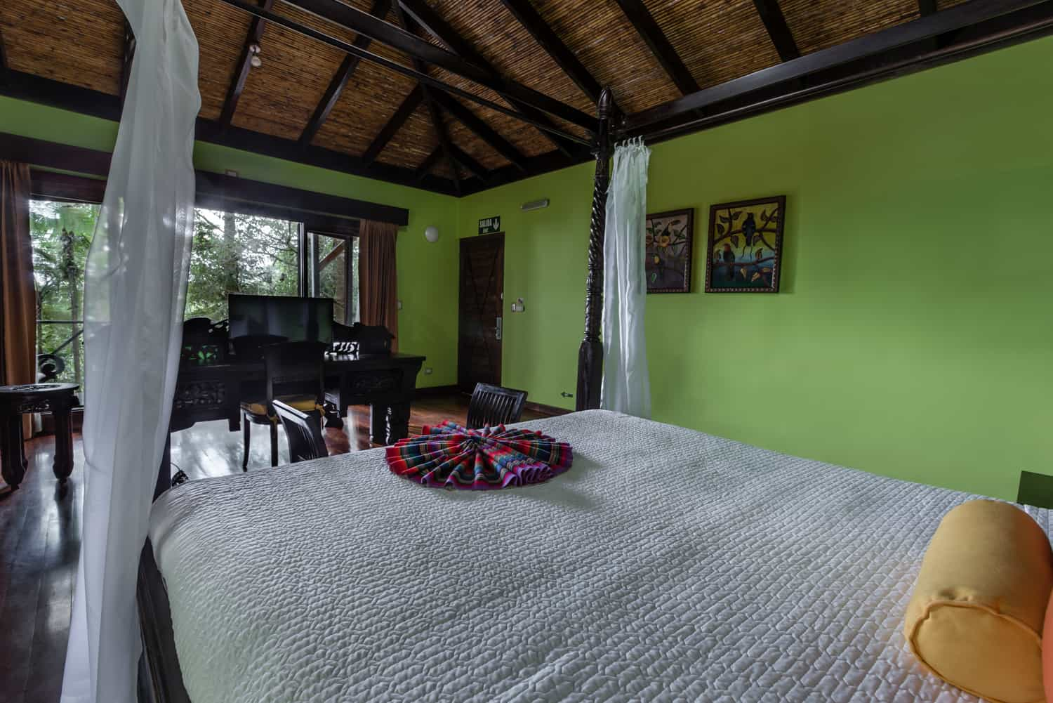 View of rainforest for canopy king bed in guest room at Rio Celeste Hideaway Hotel.