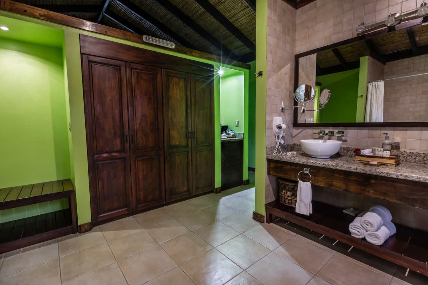 Spacious bathroom with luxury amenities at Rio Celeste Hideaway Hotel.