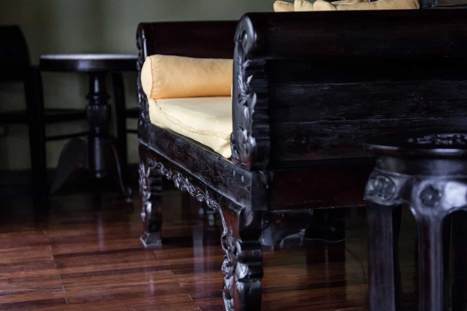 Solid wood floor in front of ornate solid wood couch at Rio Celeste Hideaway Hotel.