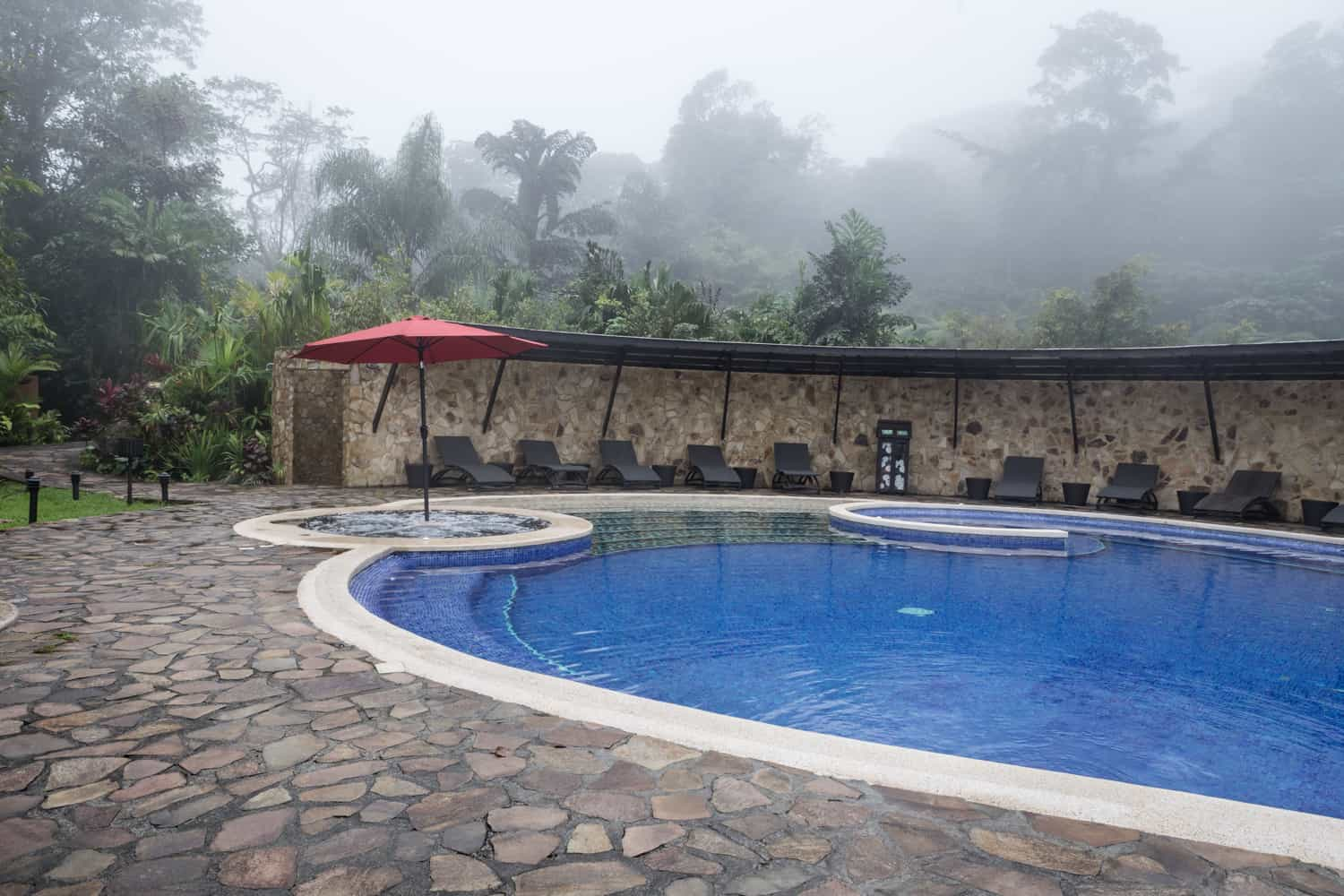 Pool area at Rio Celeste Hideaway Hotel for intimate wedding reception.