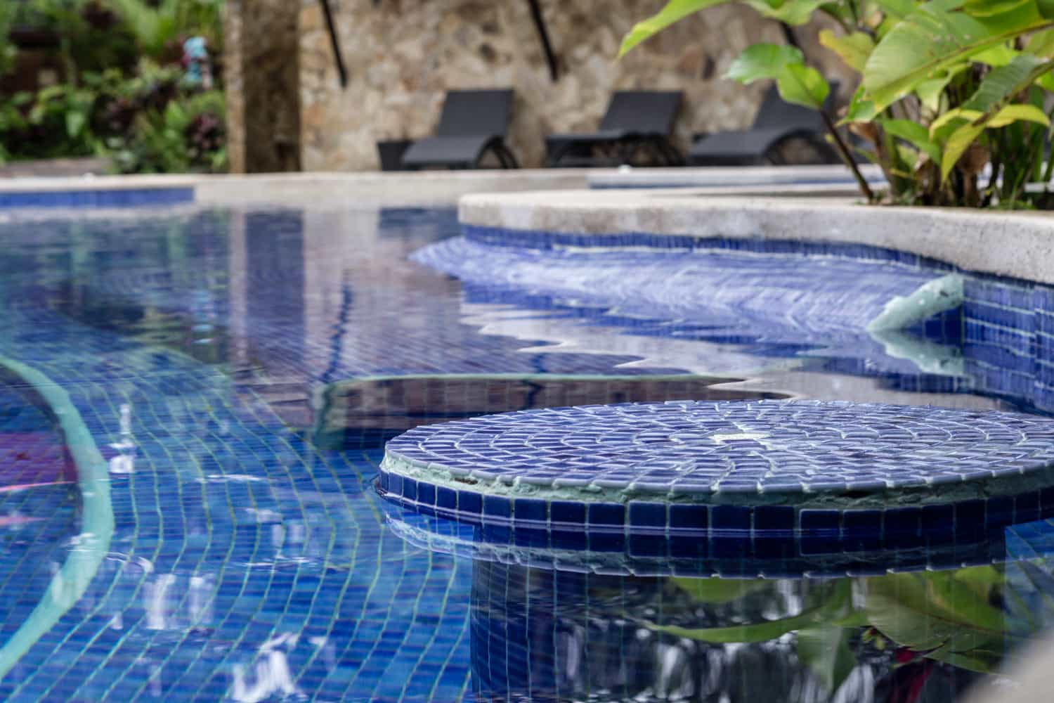 Bar stool in pool to enjoy drinks while enjoying the views at Rio Celeste Hideaway Hotel.
