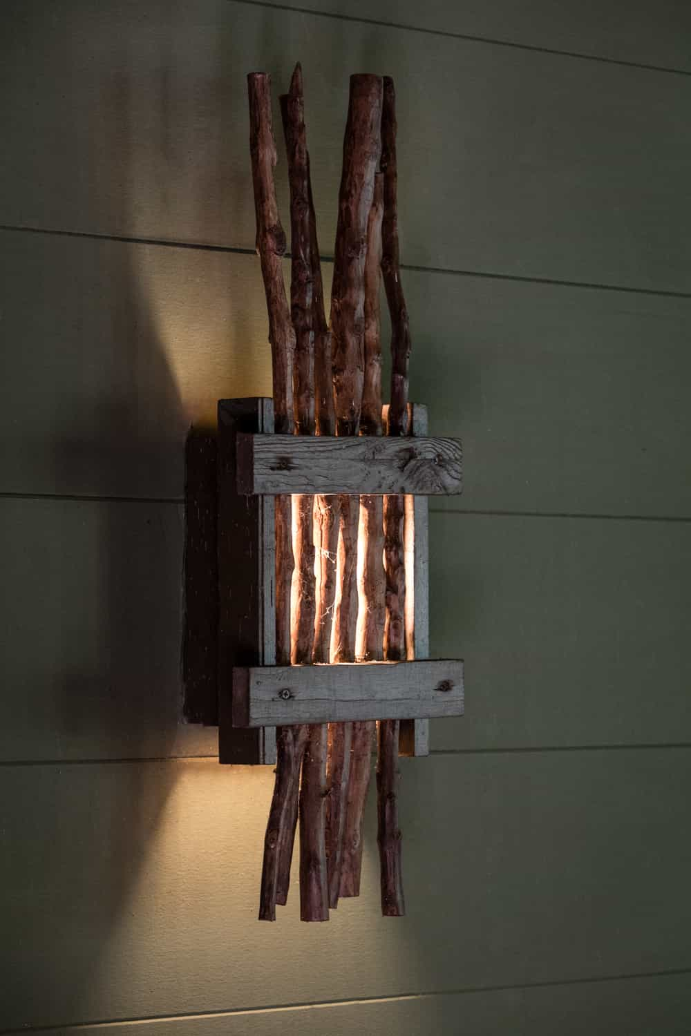 Unique light fixture on pavilion wall for wedding day events.