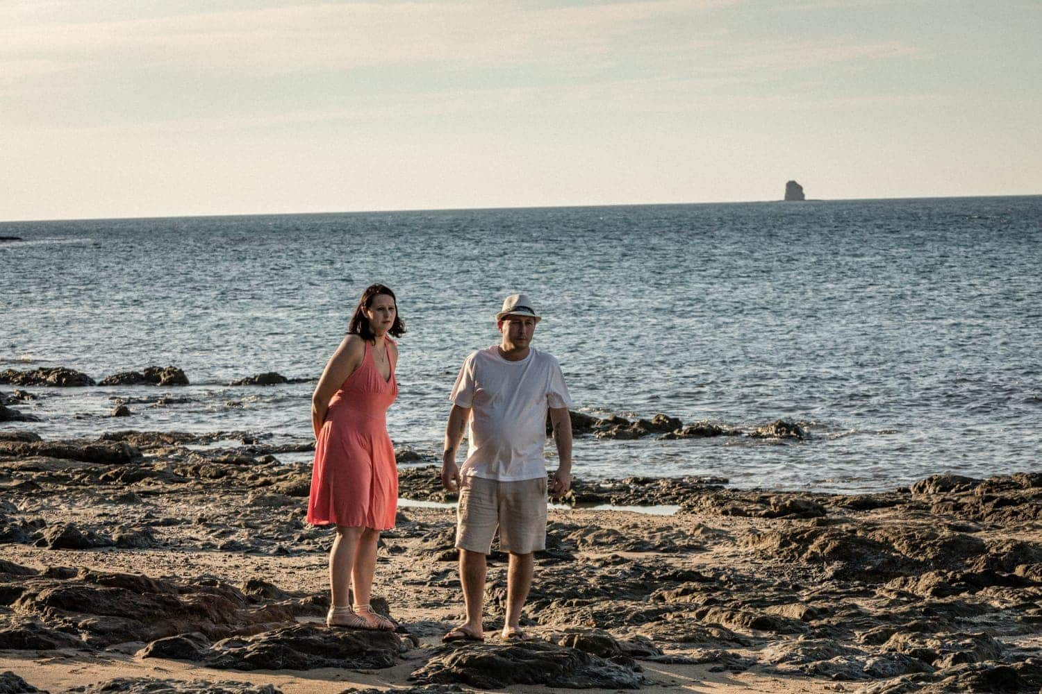 Sunset engagement of couple in love on beach by Arenas Foto.