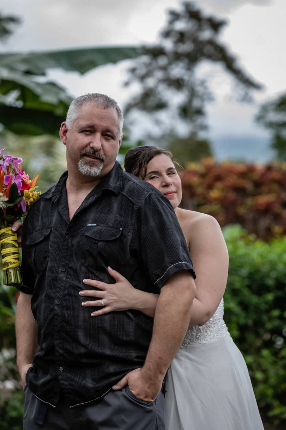 Wedding photo of bride and groom in tropical garden in Costa Rica.