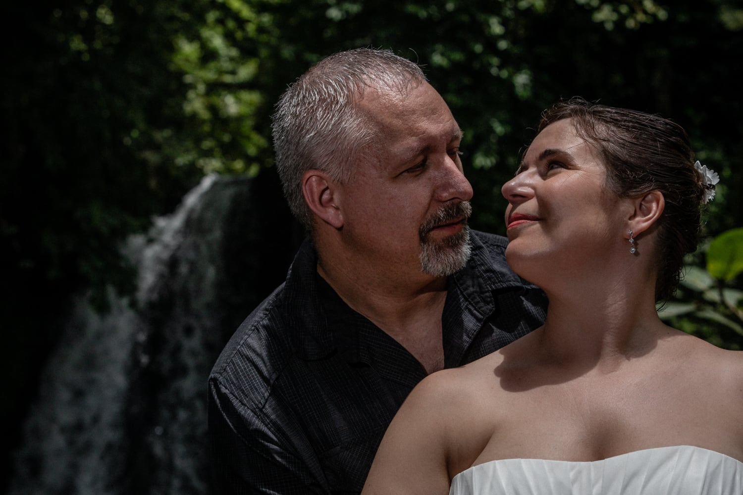 Waterfall wedding photo of just married couple in Costa Rica.