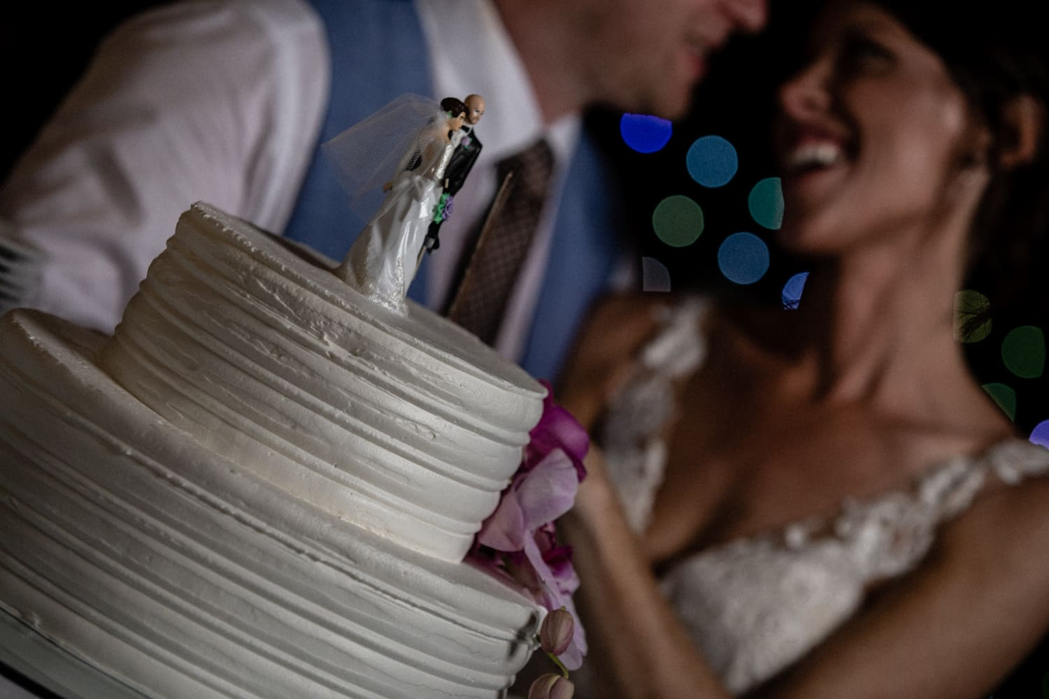 Photo of great wedding cake with bride and groom about to cut it.