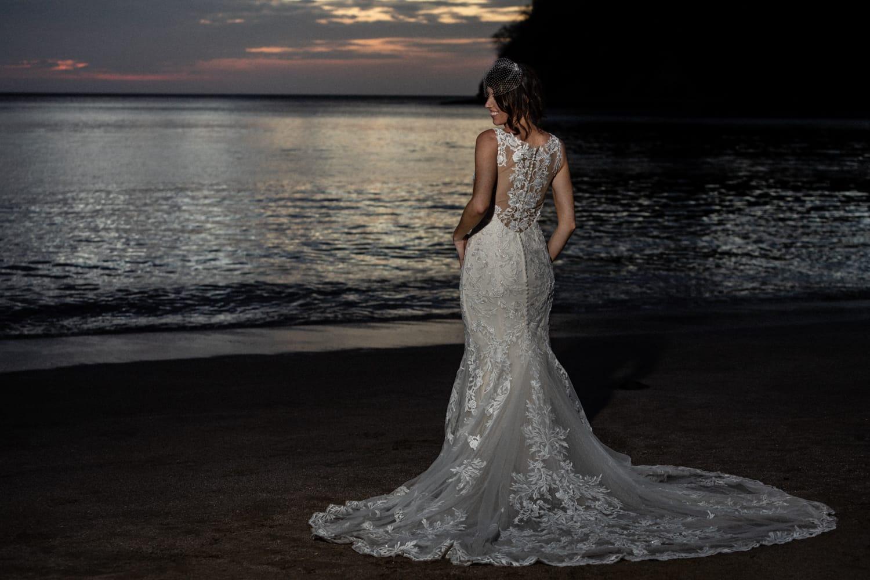 Sunset beach portrait of bride in beautiful white wedding dress in Costa Rica.