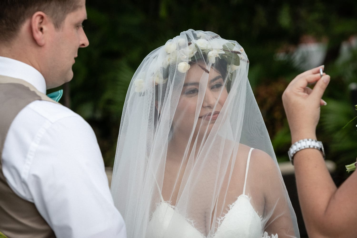 Couple getting married in Costa Rica exchange wedding rings.