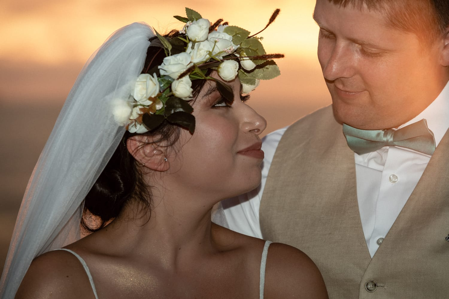 Sunset beach wedding photo of couple tying the knot in Costa Rica.