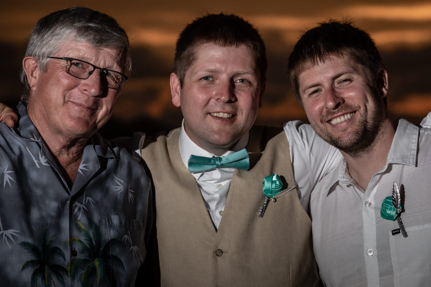 Wedding portrait of groom and best man with father.