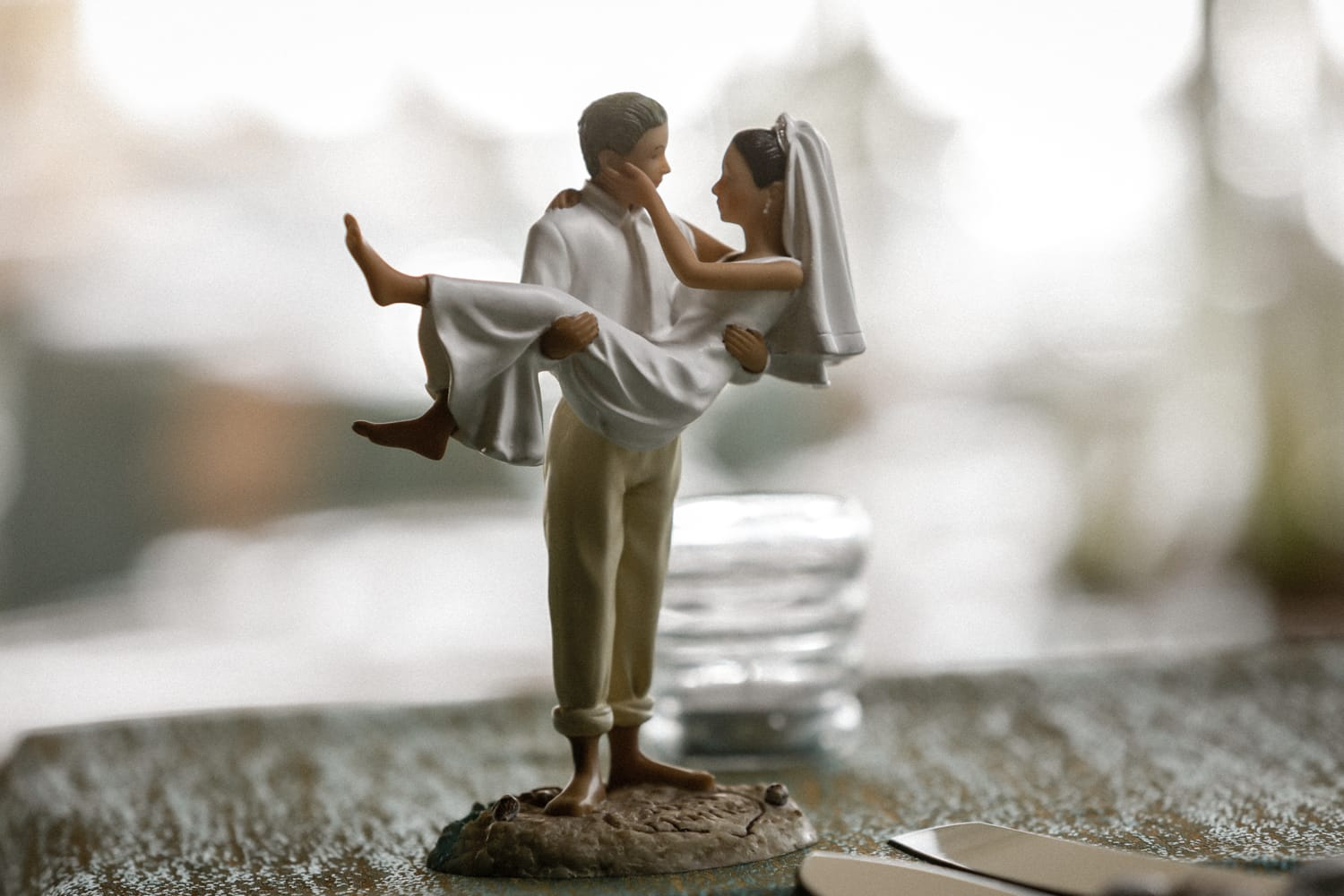 Wedding day decoration of figuring of groom carrying bride.