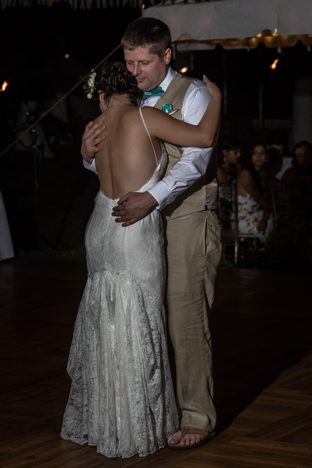 Bride and groom celebrate their wedding with their first dance.