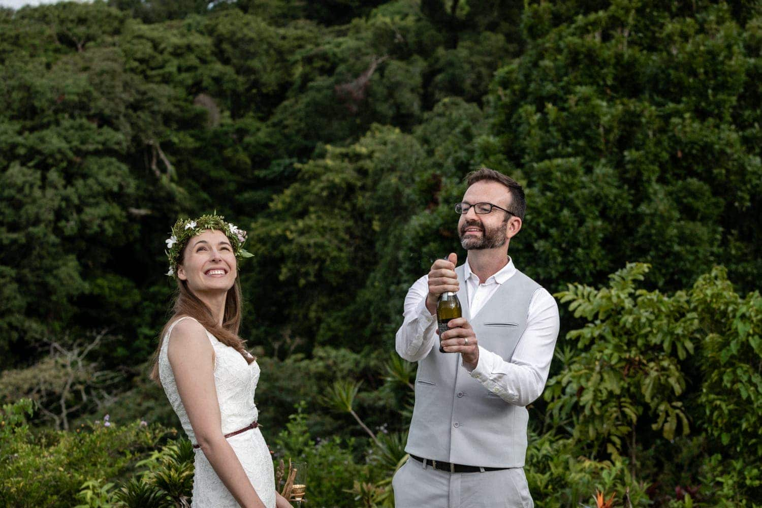 Couple breaks open a bottle of champaign after saying I do.