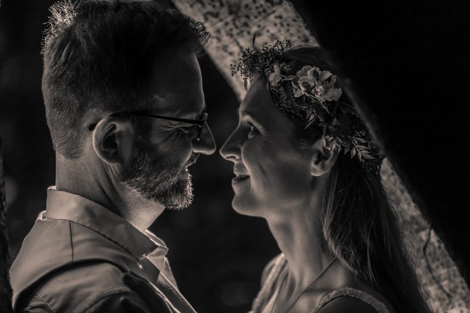 Dramatic black and white bride and groom wedding portrait in rainforest.