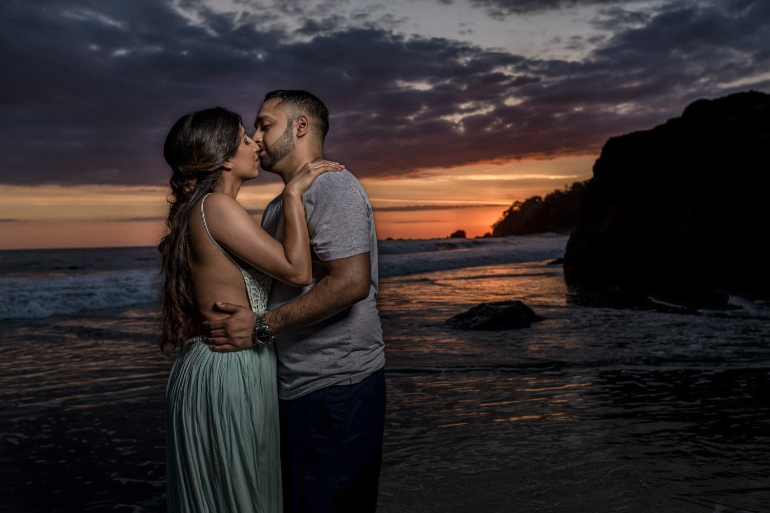 Couple smile during their Manuel Antonio engagement session.