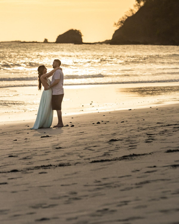 Romantic sunset beach photo of couple during Manuel Antonio engagement session.