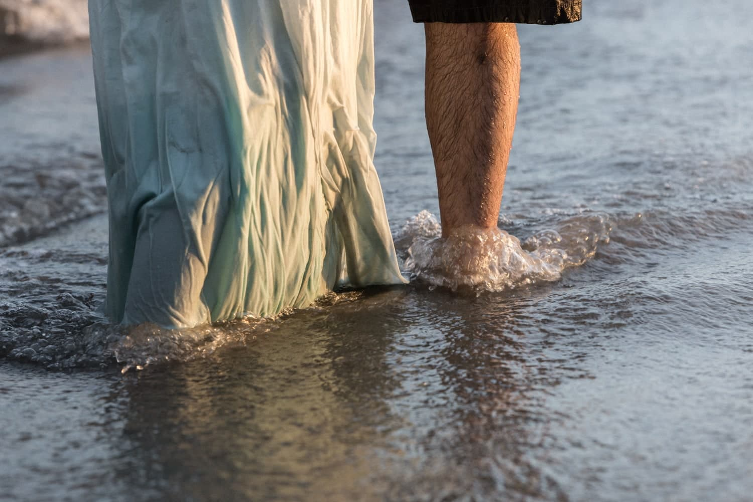 Couple in love stands in water on shore on Costa Rica beach.