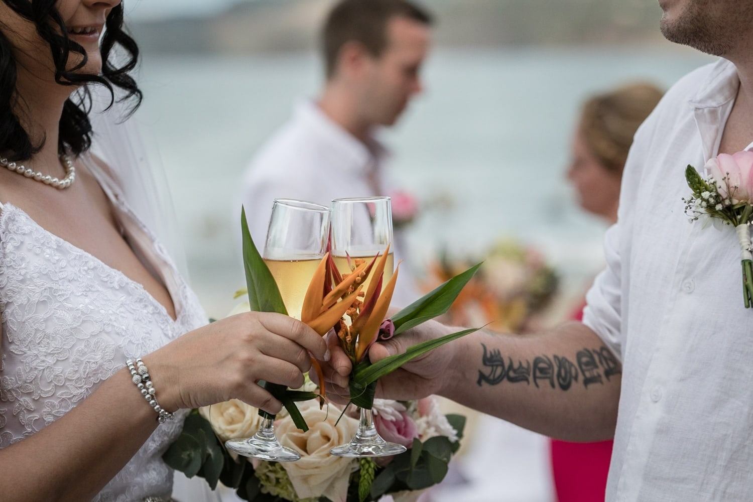 Champaign wedding flutes decorated with exotic Costa Rica flowers.