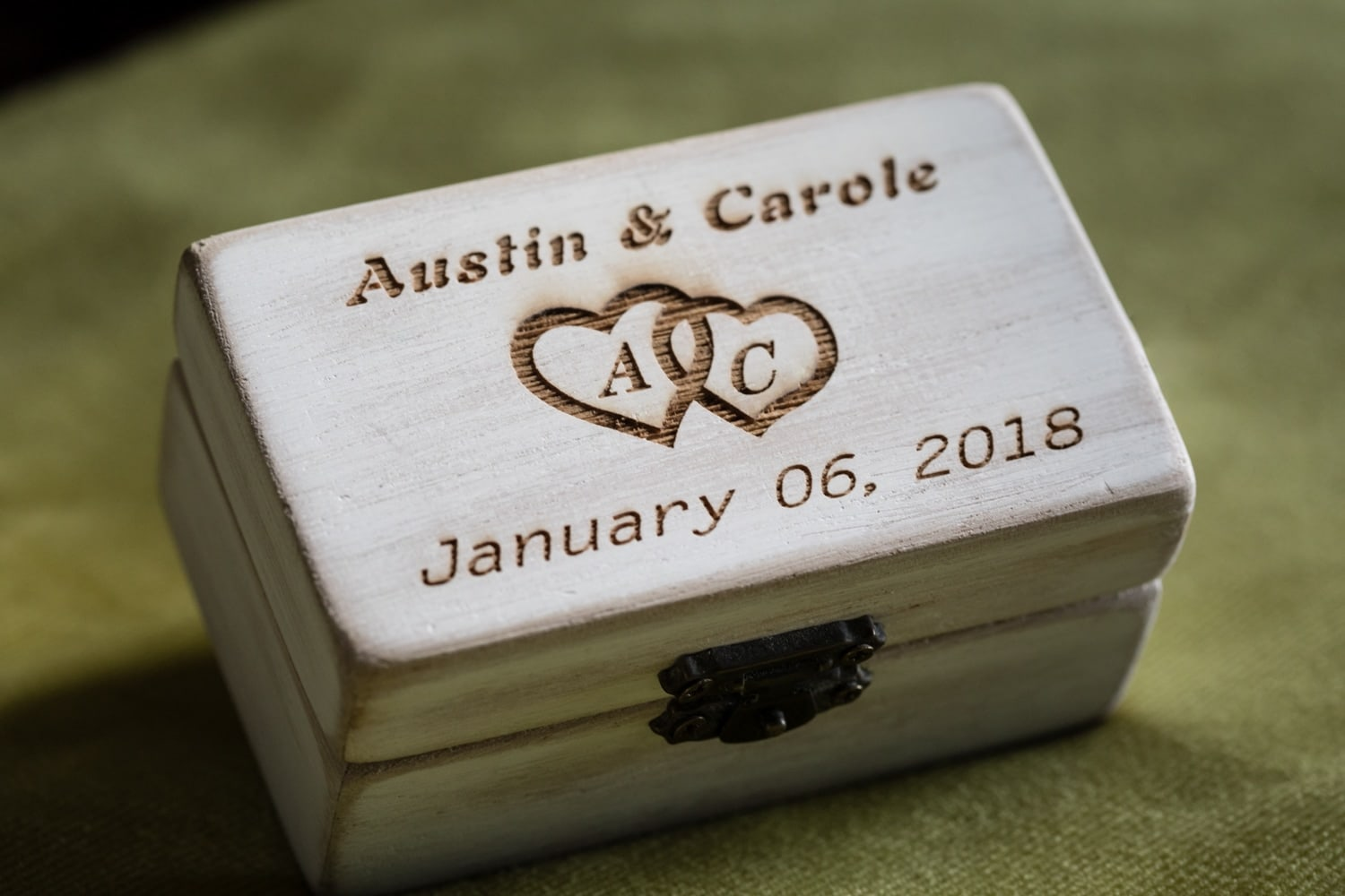 Custom-made jewelry box for bride and groom wedding bands.