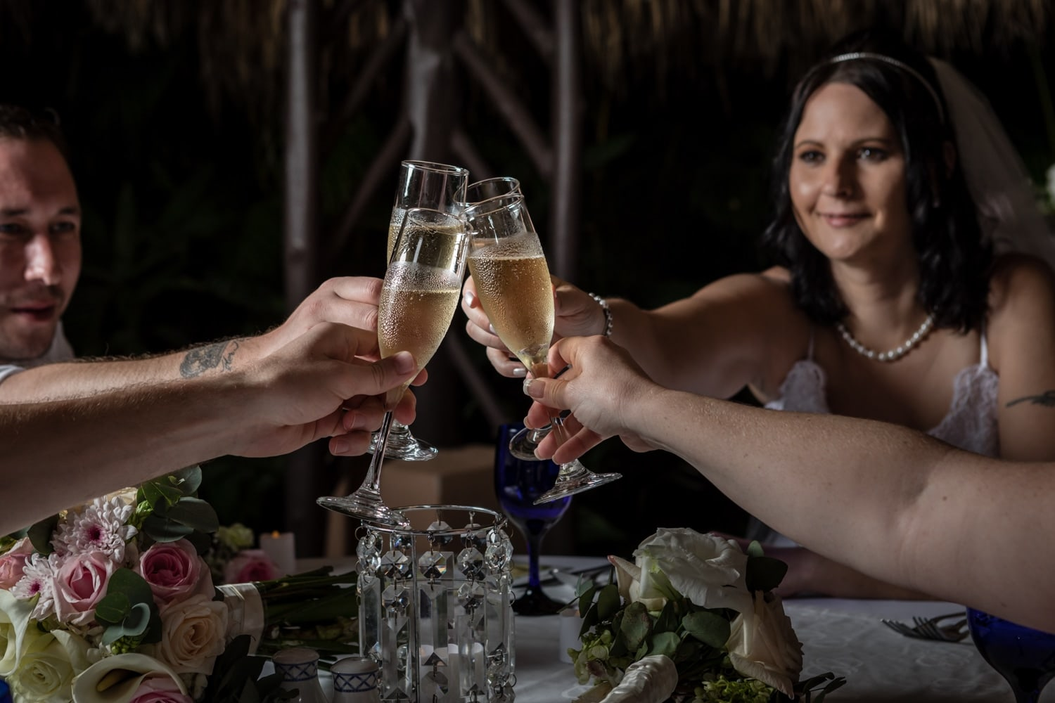 Bridal party celebrates matrimony with a toast during wedding reception.