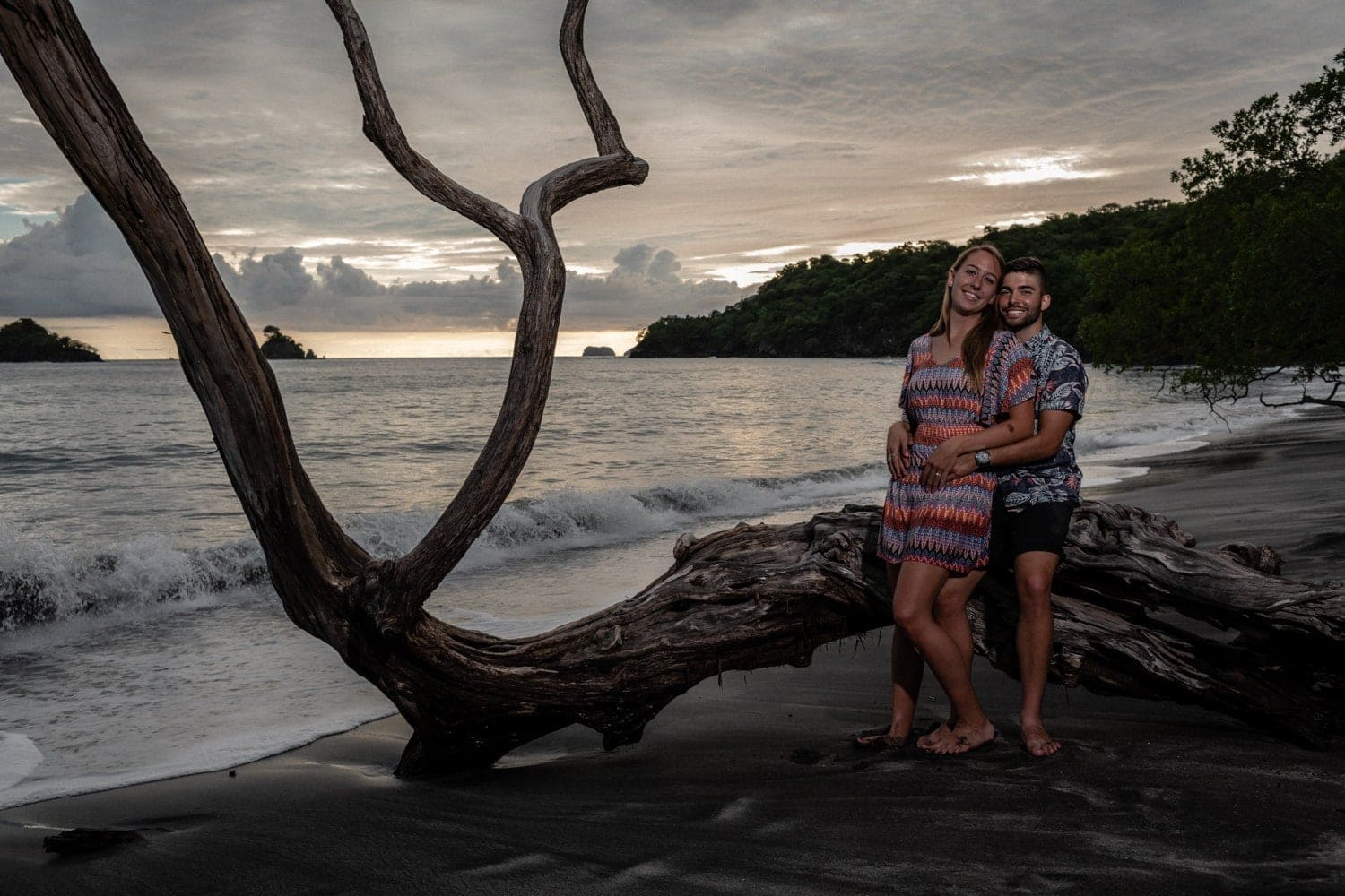 Beautiful photo of just engaged couple at sunset on a beach in Costa Rica.