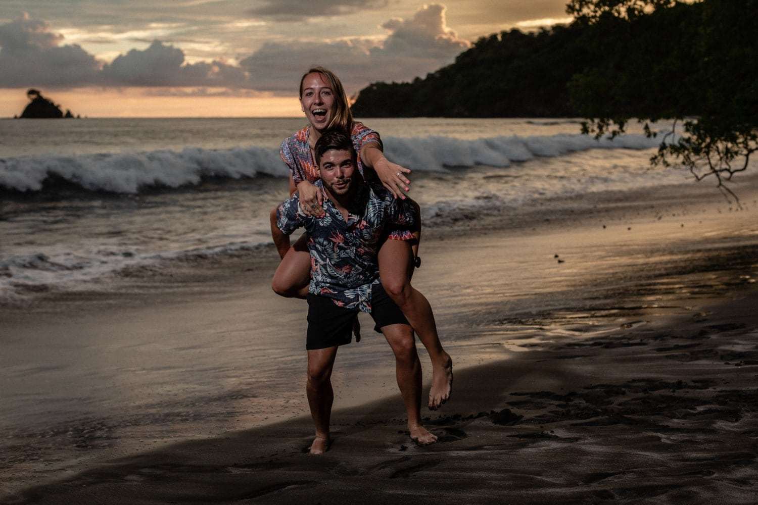 Gorgeous just engaged couple having fun on beach in Costa Rica.