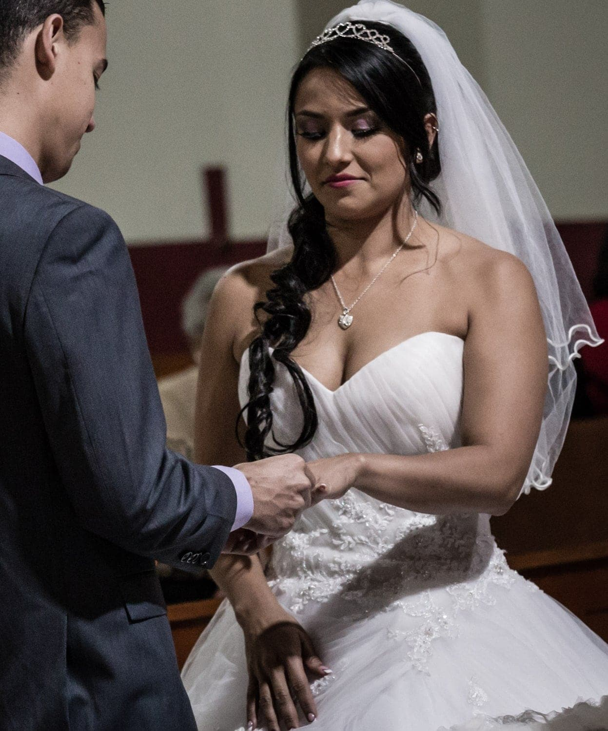 Couple exchanges wedding bands during ceremony in Costa Rica.