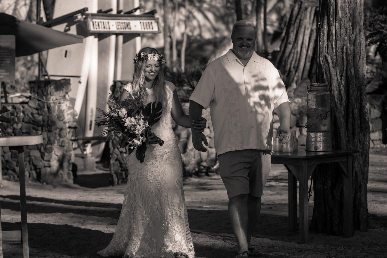 Father walks daughter down aisle at Langosta Beach Club in Tamarindo.