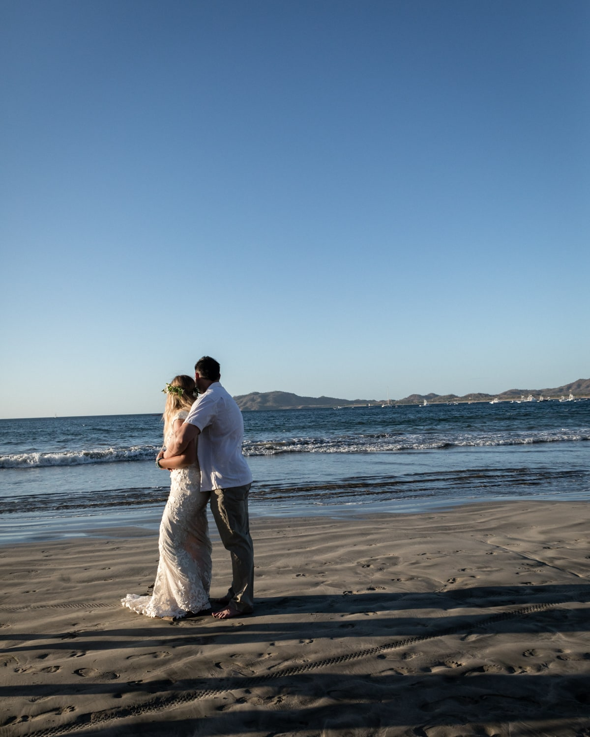 Photo of bride and groom on beach after their wedding at Langosta Beach Club.