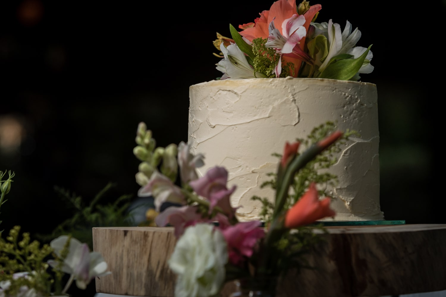 Tropically decorated wedding cake during reception at Langosta Beach Club.