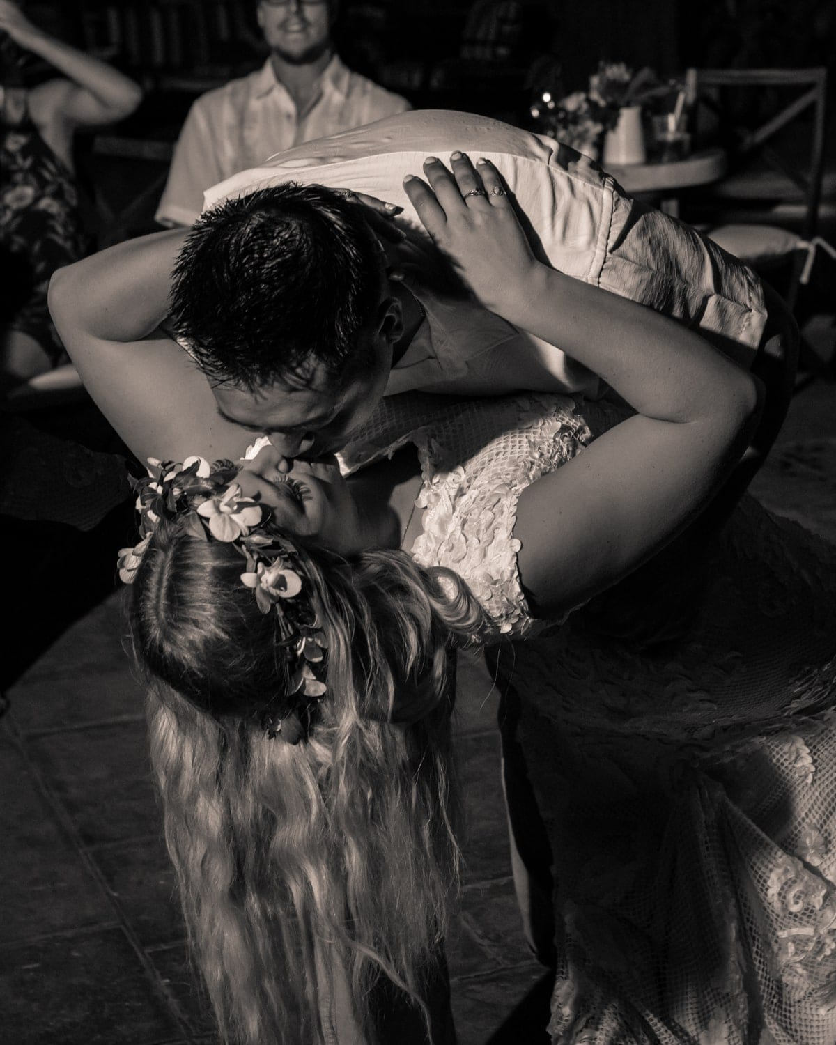 A just married couple's passionate kiss during first dance at Langosta Beach Club.