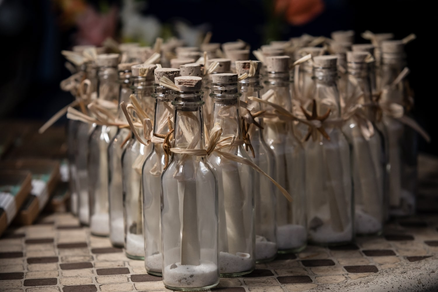 The bottles with a message inside are a unique wedding favor.