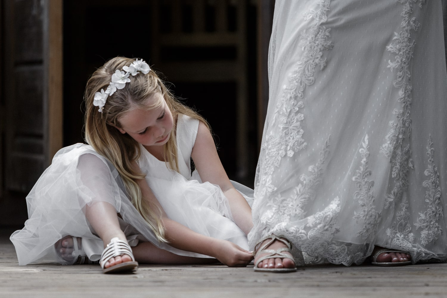 Flower girl helps bride prepare for her wedding day.