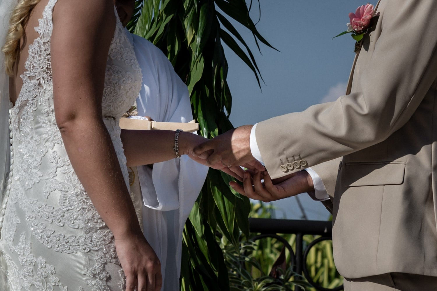 Couple ties the knot and exchanges wedding rings.