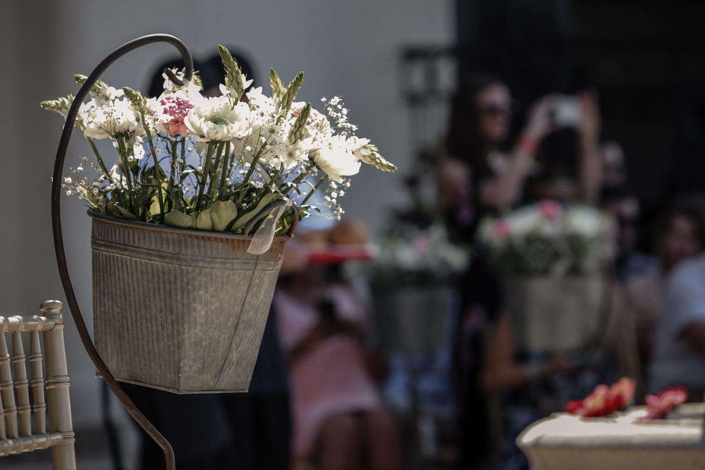 Floral arrangement decorating outdoor wedding venue in Costa Rica.